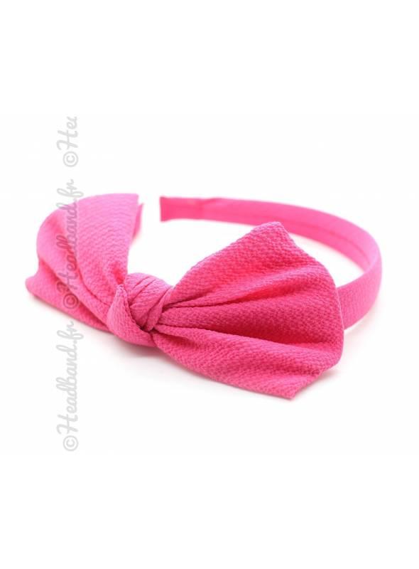 Serre-tête noeud en crêpe rose