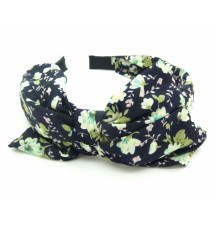Serre-tête double nœud imprimé fleuri porté