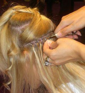 Pose d'extensions de cheveux à anneaux